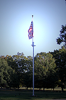 Click to enlarge photo of Flag Flying in front of Presidential Library.